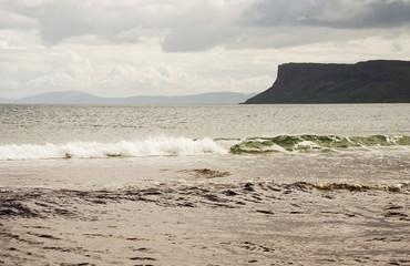 View of Fair Head Cliffs and Scotland from Ballycastle Beach Ireland