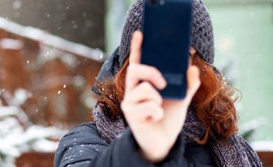 woman taking a selfie in snow