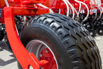 Close up side view photo of fragment huge cleen tire wheel of construction or agriculture auto equipment