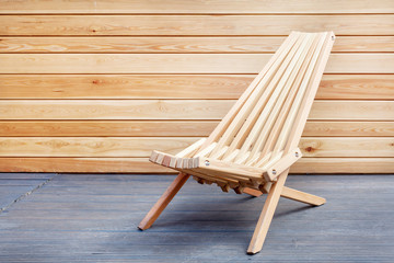 Photo of cozy place for sitting against wooden panel. Perfect chair stand on terrace Fototapete