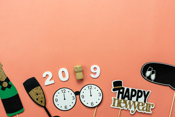 Table top view of Merry Christmas decorations & Happy new year 2019 ornaments concept.Flat lay essential difference objects to party season the photo booth prob on modern pink paper background.
