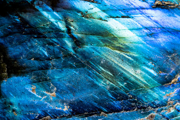 This is a macro photo of a blue crystal moonstone.  I used special lighting to bring out the mineral textures. and saturated colors.