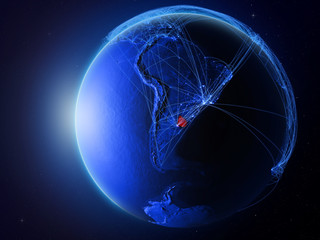 Uruguay from space on planet Earth with blue digital network representing international communication, technology and travel.