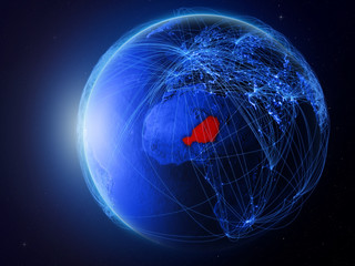 Niger from space on planet Earth with blue digital network representing international communication, technology and travel.