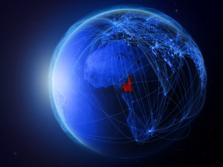 Cameroon from space on planet Earth with blue digital network representing international communication, technology and travel.