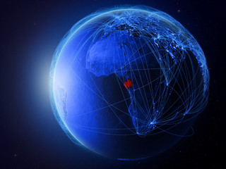 Gabon from space on planet Earth with blue digital network representing international communication, technology and travel.