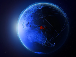 Papua New Guinea from space on planet Earth with blue digital network representing international communication, technology and travel.