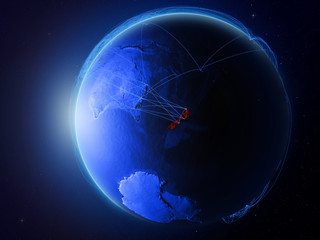 New Zealand from space on planet Earth with blue digital network representing international communication, technology and travel.