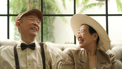 Retro Asian elderly couple happy classic style house