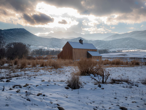 Picturesque barn in a winter mountain landscape