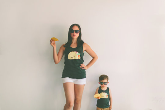 A woman and a boy wearing matching taco shirts.