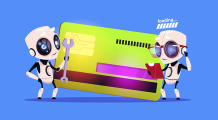 Wall Mural - Modern Robots Standing Over Credit Card Reading Documents And Holding Spanner Robotic Technology Payment Concept