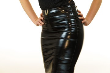 Woman wearing leather latex skirt.