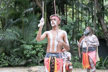 Indigenous Australians.Men Dancing to Didgeridoo Musical Instrument Sound Rhythm