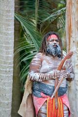 Adult Indigenous Australian.Man Holding Boomerangs