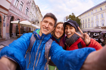 couple happy tourists making selfie on the streets of Lviv