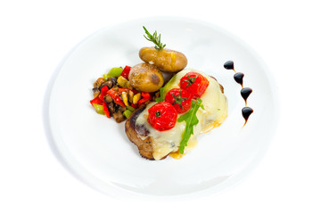 Pork Medallions with Potato and Mushrooms isolated on white.