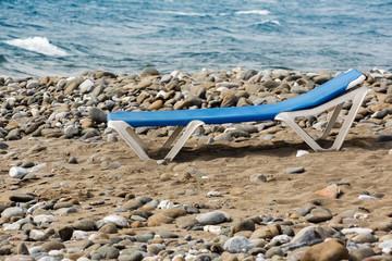 Sunbed on a Stony Beach