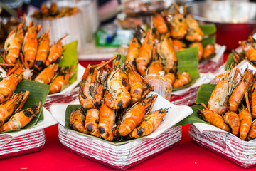 Grilled shrimps seafood on the table in market of Bangkok Thailand