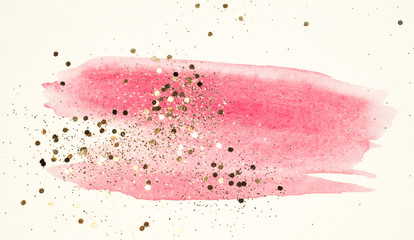 Abstract pink watercolor splash and golden glitter in vintage nostalgic colors.