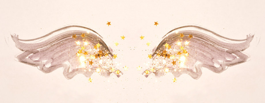 Golden glitter and glittering stars on abstract black watercolor wings in vintage nostalgic colors.