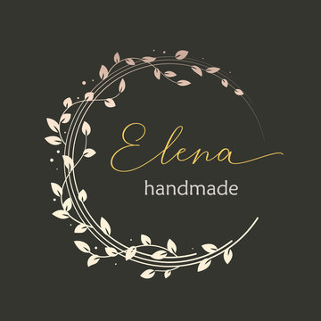 Premade logo design with golden floral wreath. Tree branches and leaves. Feminine logotype template
