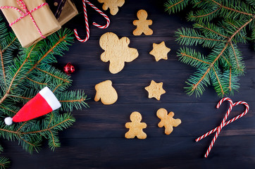 Christmas composition with gingerbread on wooden table