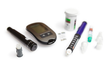 Diabetic set of lancet with spare needles, glucometer, strips, box of spare strips, pen injector, spare insulin and pen needles isolated on white background