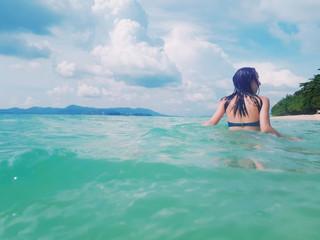 Beautiful woman swimming in the blue sea