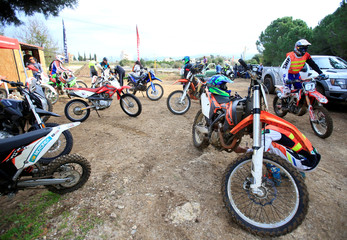 Riders sit on their motorbikes at MX Academy Lebanon in Aabrine
