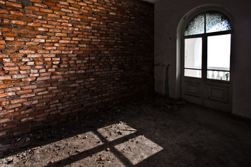 A window, a boiling wall and a shadow in the shape of a cross, a symbol of psychological problems and drug addiction.