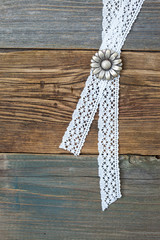 silvery button flower and lace tape