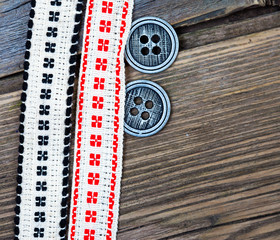 two vintage tape with embroidered ornaments and old buttons