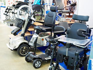 Wheelchairs with electric motor in store Wall mural
