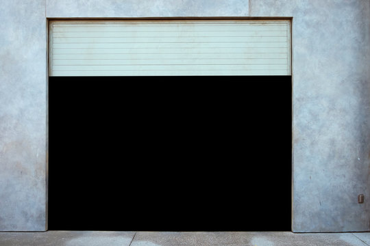 GARAGE DOOR WITH BLACK AND YELLOW CAUTION STRIPES