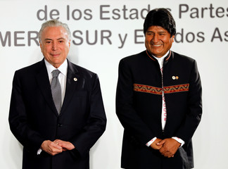 Brazil's President Michel Temer and Bolivia's President Evo Morales look on while posing for a family picture during a Mercosur trade bloc summit in Montevideo