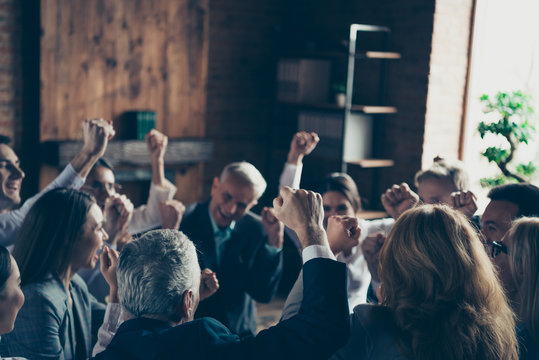Crowd briefing committee of nice cheerful elegant classy professional rich wealthy business people management celebrating great success raising hands up at work place station