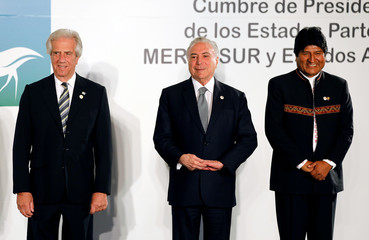 Uruguay's President Tabare Vazquez, Brazil's President Michel Temer and Bolivia's President Evo Morales look on while posing for a family picture during a Mercosur trade bloc summit in Montevideo