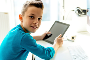 Teenage boy holding digital tablet