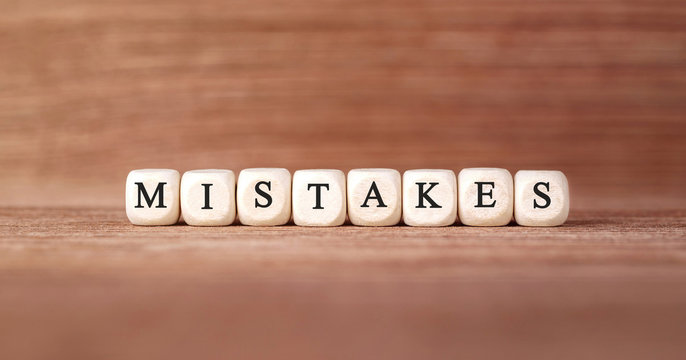 Word MISTAKES made with wood building blocks