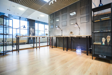Background image of glass displays in luxury jewelry store interior copy space