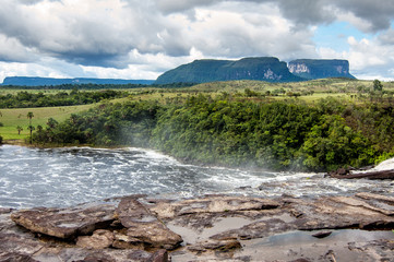 scenic landscape of wild and pristine venezuela canaima park with majestic waterfalls and dramatic cloudy sky and tepuy