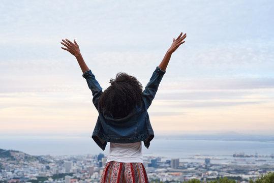 African american woman overlooking the city below