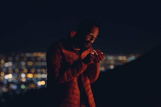 Cinematic shot of man lighting a cigarette