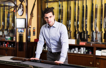 Salesman showing rifle