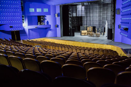 Empty auditorium and stage in the theater. Rehearsal of the play. Artists on stage.
