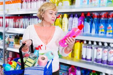 woman choosing household chemical goods