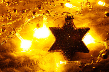 Christmas and New Year decorations star on lights background