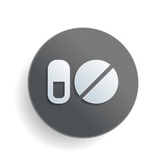 simple symbols of pills or vitamins. White paper symbol on gray round button or badge with shadow