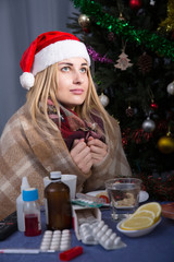 Girl in a plaid is ill of virus in the New Year night